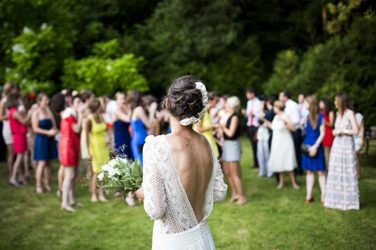 Bride Preparing to Throw her Wedding Bouquet