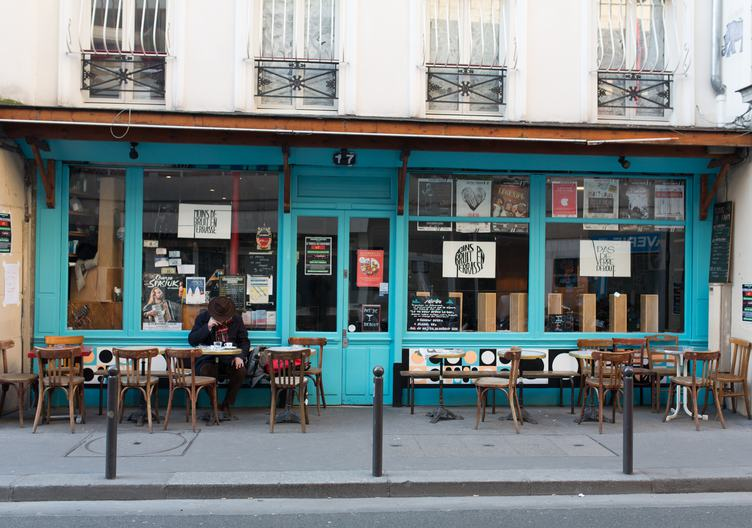 Sidewalk Terrace of a Blue Facade Cafe
