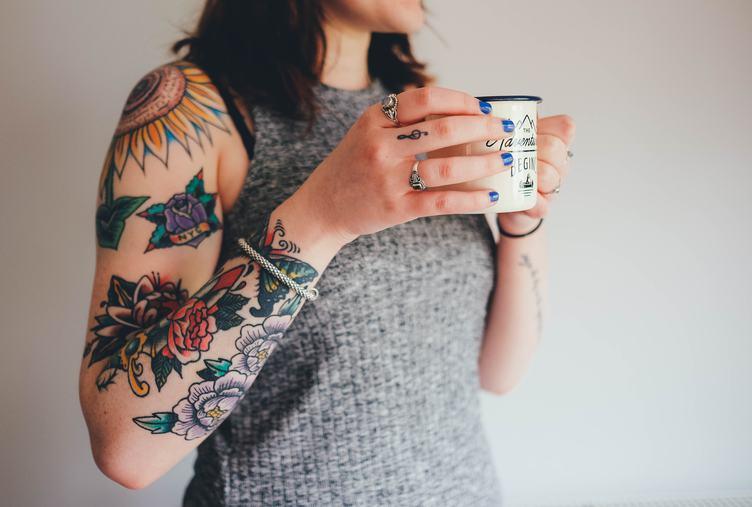 Tattooed Woman Holding a Mug