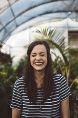 Brunette Laughing with Closed Eyes