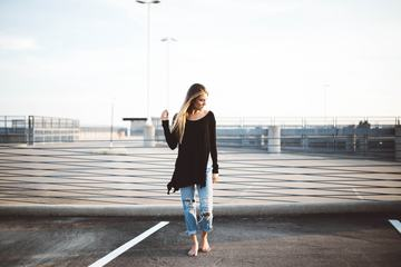Barefoot Blond Girl in Torn Jeans