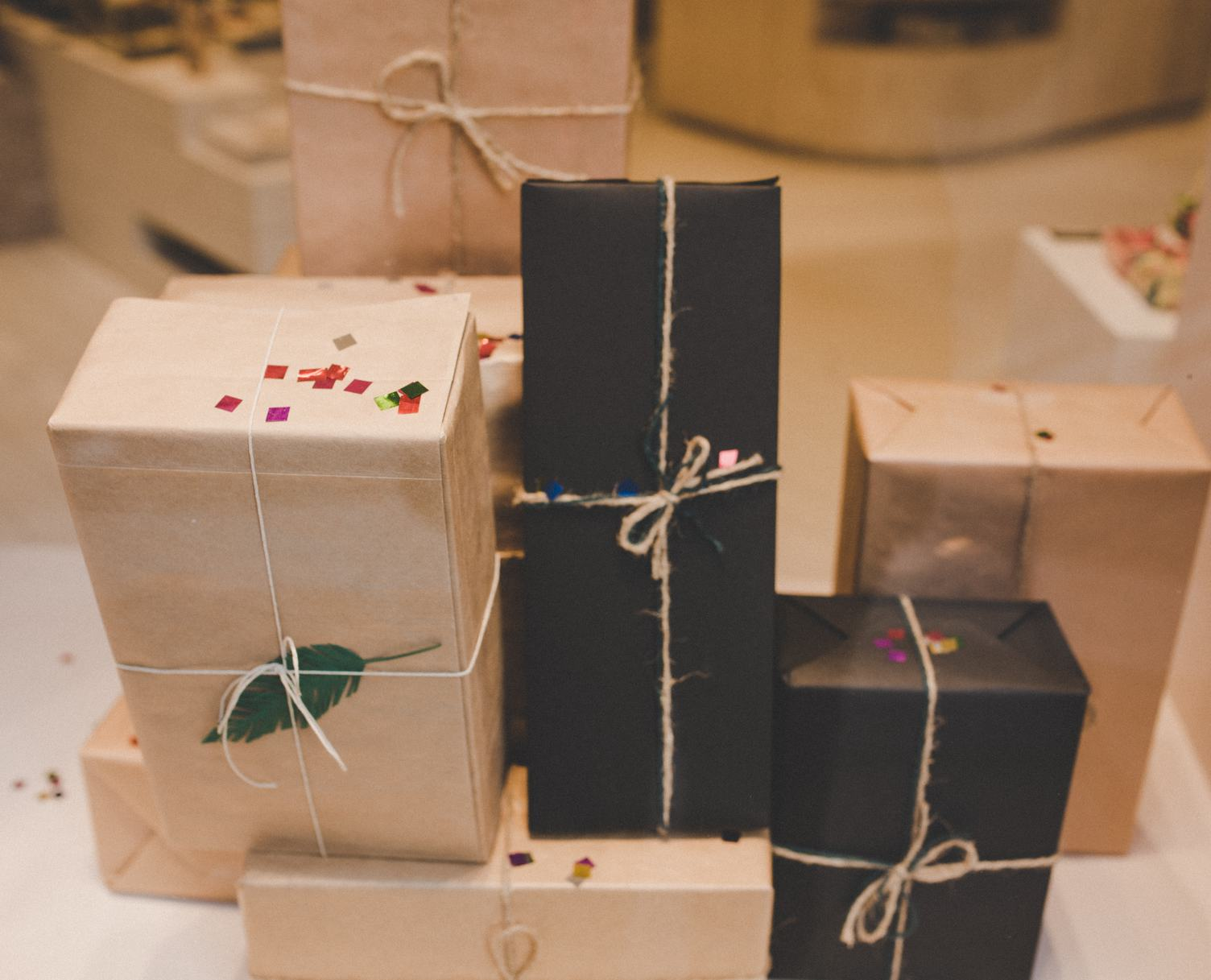 Multiple Gifts Wrapped in Paper with Twine Ribbons