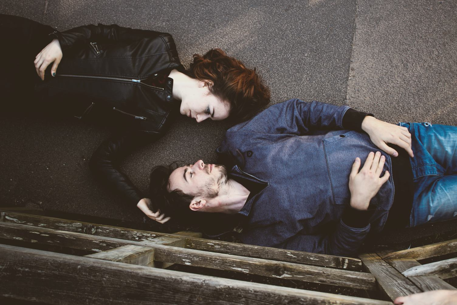 Man and Woman Together Lying on a Floor