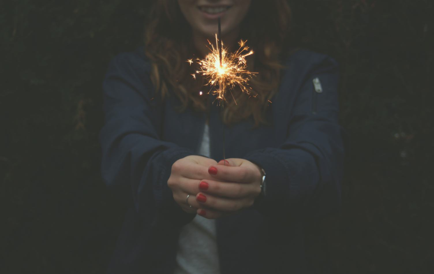 Woman with Red Nails Playing with Sparklers