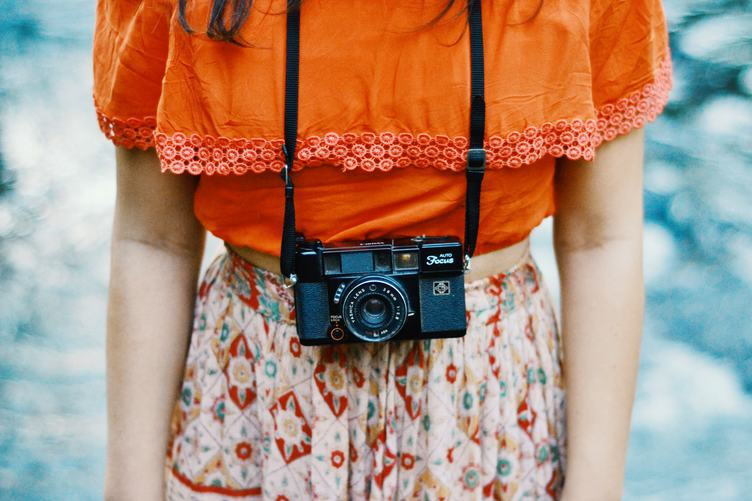 Vintage-Style Dressed Girl Photographer with her Camera