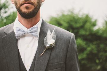Bearded Groom in Elegant Suit with a Bow Tie