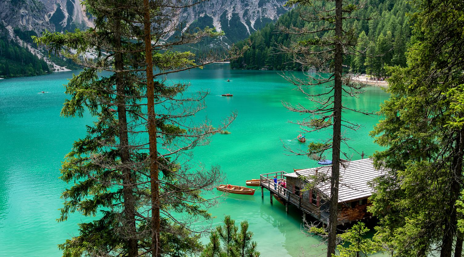 View of a Cabin by a Mountain Lake