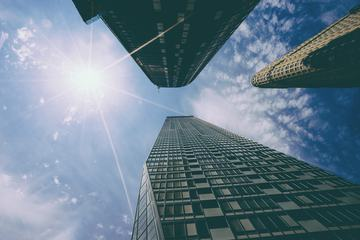 Look Up at Skyscrapers under the Sunny Sky