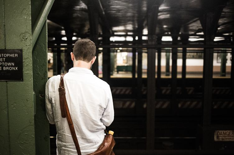 Back of a Man Waiting at the Station