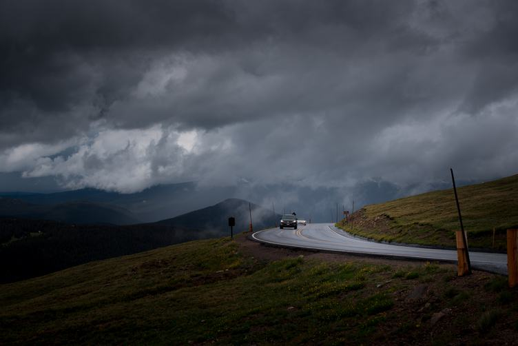 Curved Asphalt Road in a Mountainous Landscape before Storm
