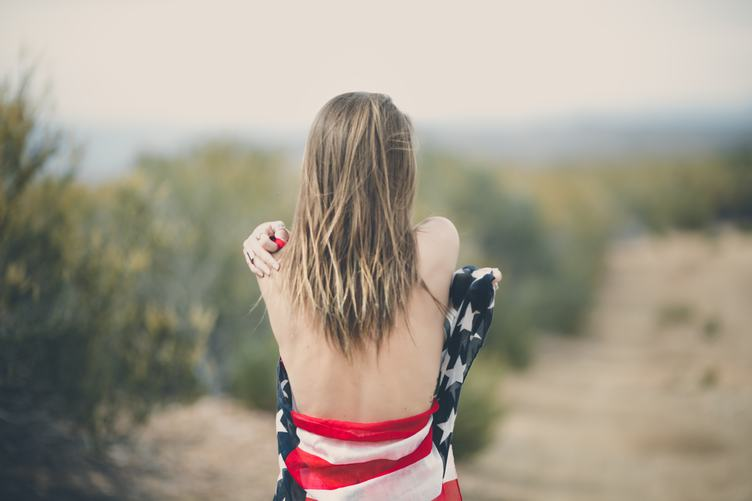 Blonde with Naked Back Wrapped in American Flag