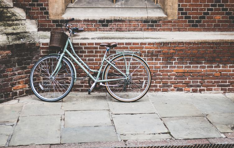 Vintage Bike with a Basket Against a Red Bricks Wall