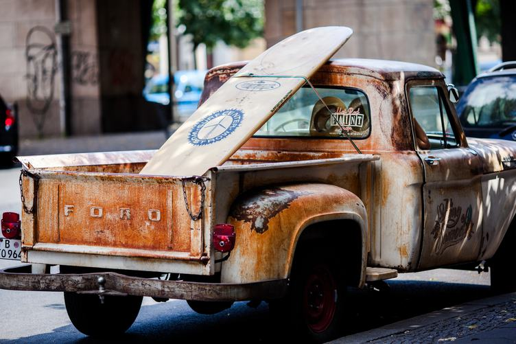 Rusty Pickup with a Surf Board