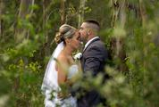 Bride and Groom Kissing in the Forest