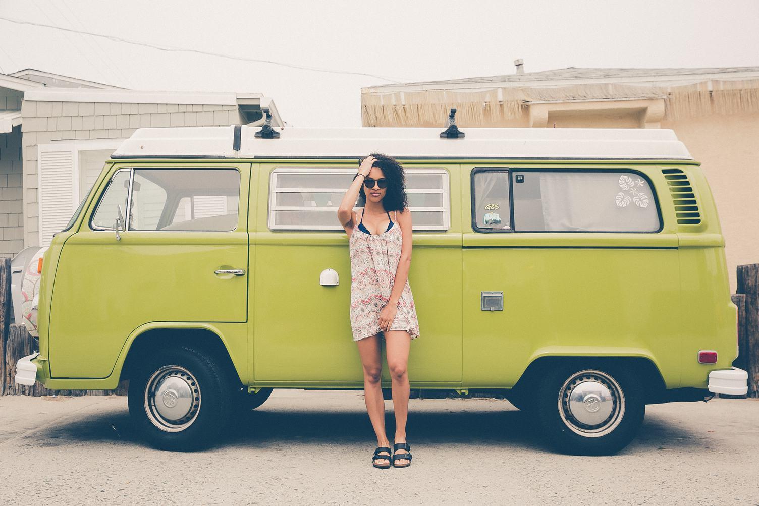 Woman Standing in front of Volkswagen Minibus