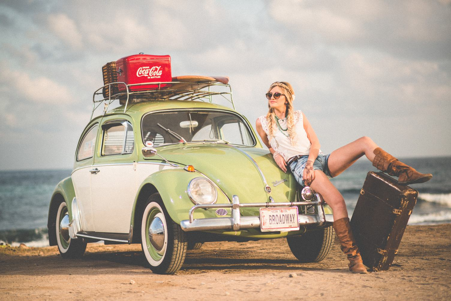 Blonde Girl with Braids and Green Retro Volkswagen Beetle
