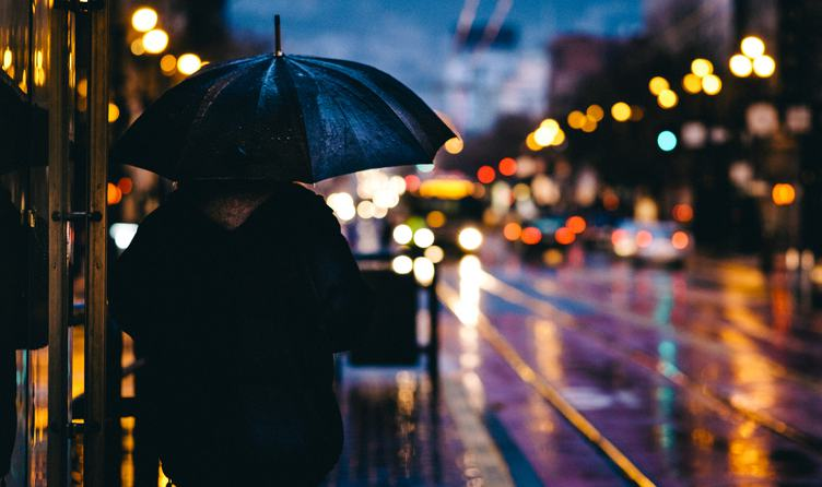 Person under Umbrella in the Evening City
