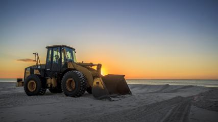 Yellow Bulldozer on the Beach