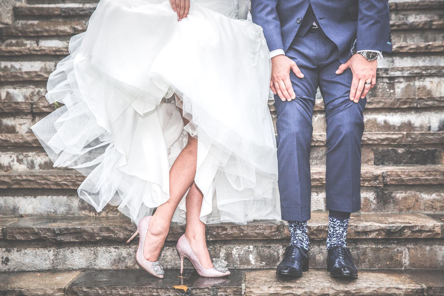 Legs of Bride and Groom on Stairs