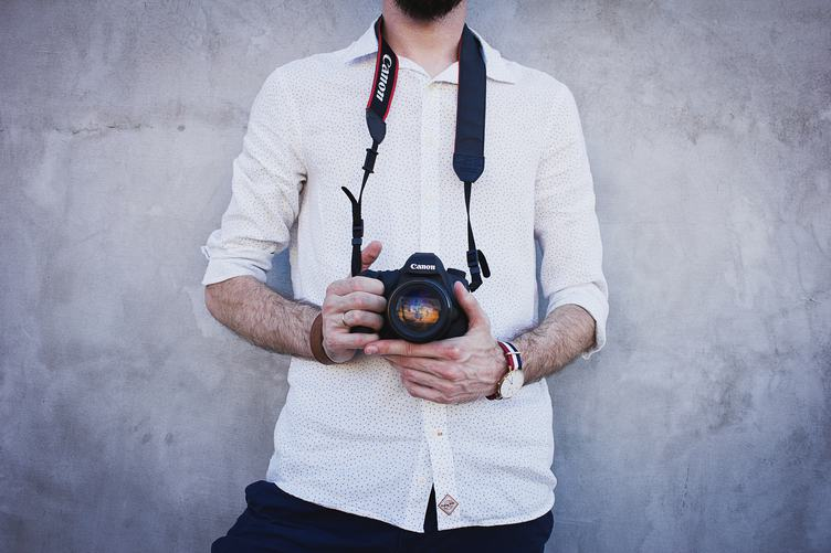 Man Standing with Camera