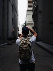 Man with a Backpack Taking Pictures