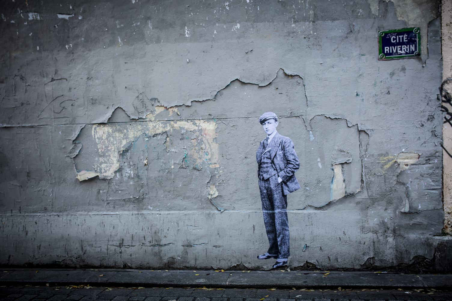 Grunge Peeling Wall with a Boy Painted on