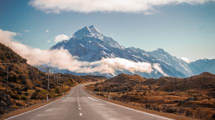 Road Leading Towards a Snow Capped Mountain in New Zealand