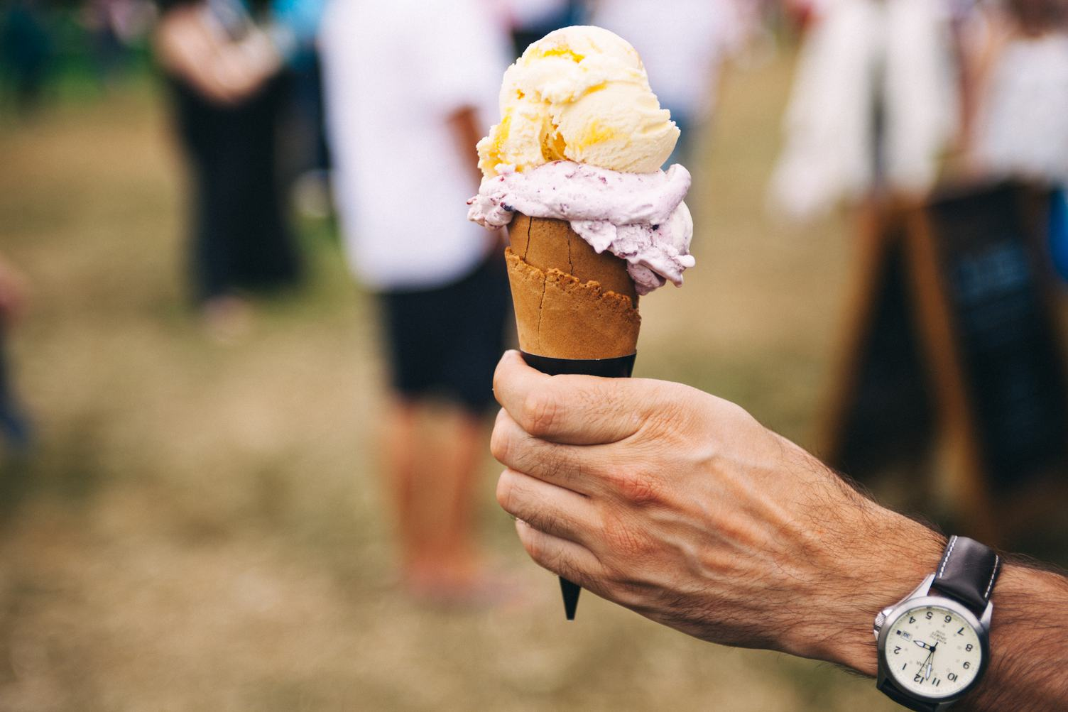 Ice Cream in the Cone on a Man Hand