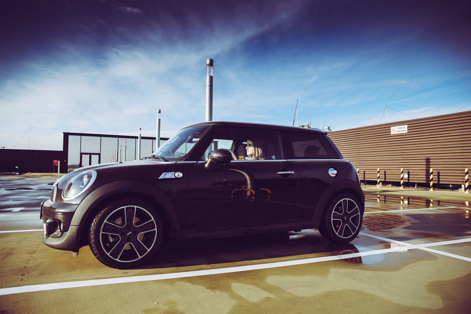 Woman Sitting in Black Mini Cooper
