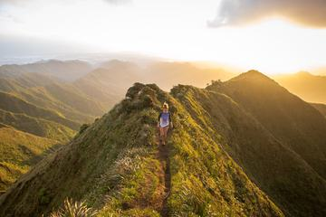 Woman Running in Mountains at Sunset