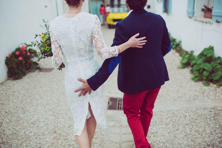 Back Wedding Shot of Bride and Groom Walking