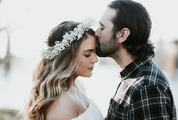 Beard Man Kisses in Forehead Beautiful Woman with Floral Wreath