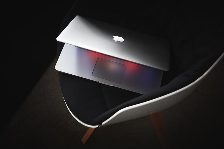 MacBook on Black Modern Chair