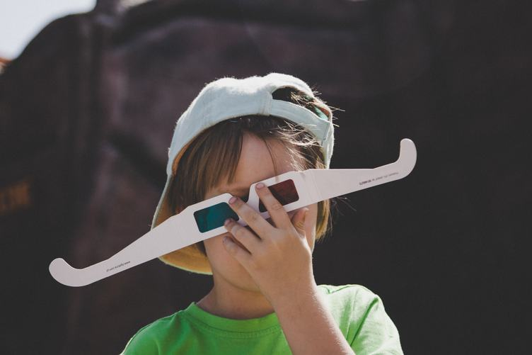 Boy Holding upside down 3D Glasses