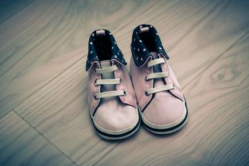 Pink Infant Shoes on Wooden Floor