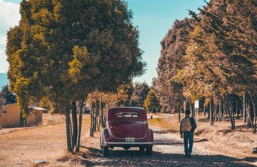 Old Classic Car on a Gravel Road