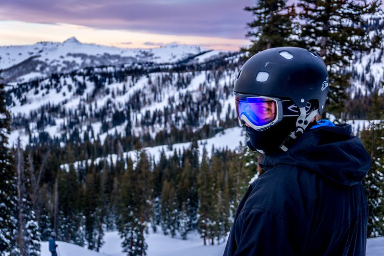 Portrait of Snowboarder in Helmet and Sunglass Mask
