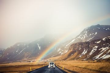 Beautiful Rainbow over Road and Mountain