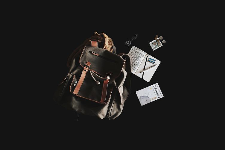 Backpack, Book, Money, Notes on the black Background