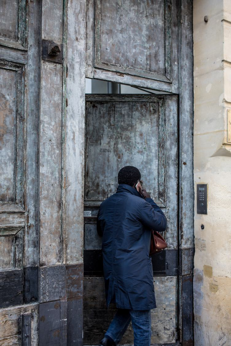 Man Wearing Navy Blue Jacket Opening the Door