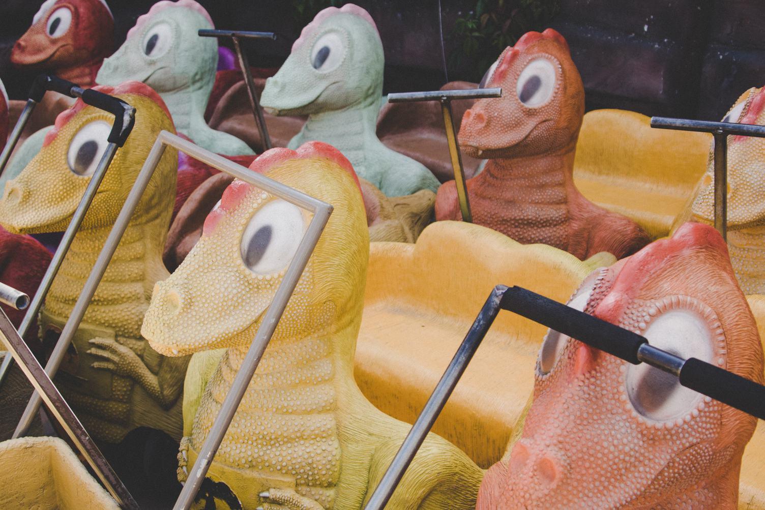 Yellow and Orange Dinosaurs Handcarts in JuraPark