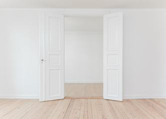 White Door in Empty Apartment Room with Wooden Floor
