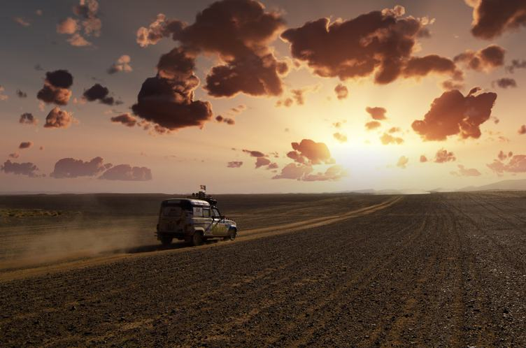 Offroad Trail Car Speeding Through the Desert at Sunset