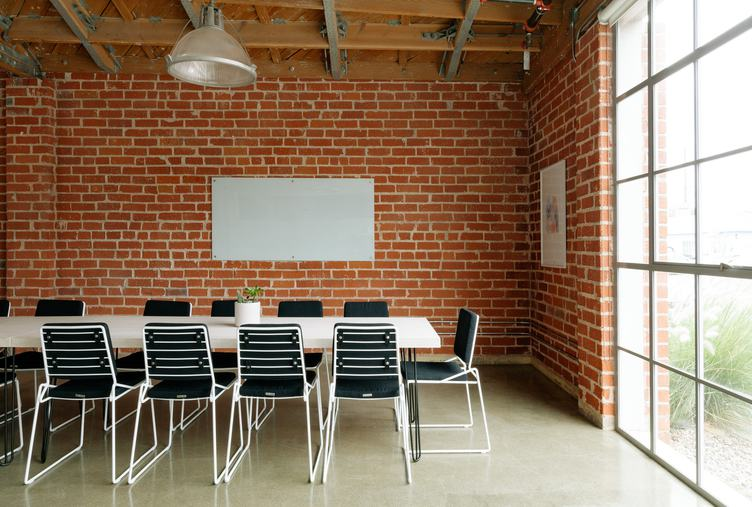 Conference Room in a Loft Style with Red Brick Walls