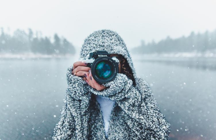 Woman Holding Nikon Camera Photographing Outdoors in Winter