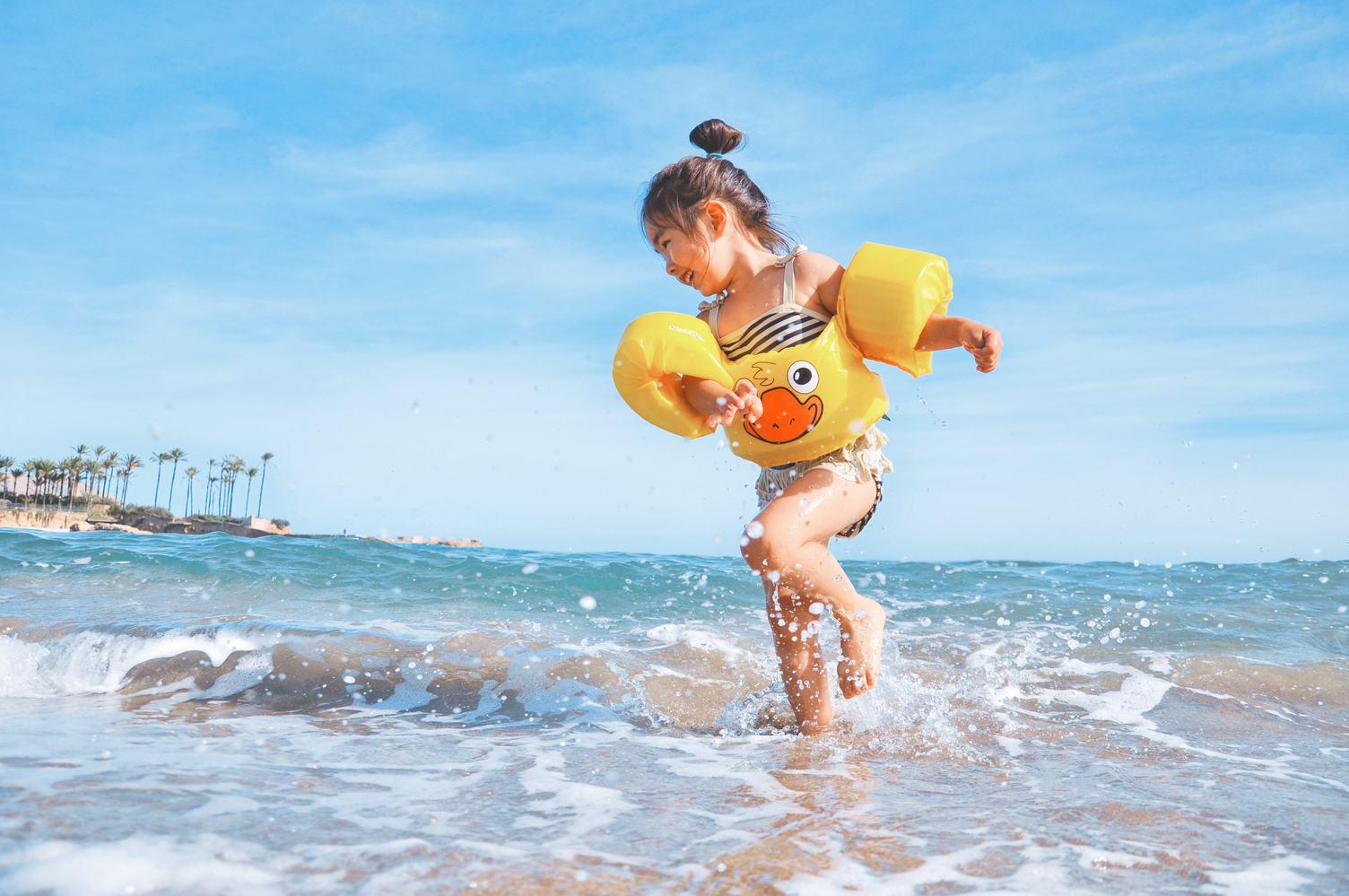 Happy Kid Girl Running the Summer Beach