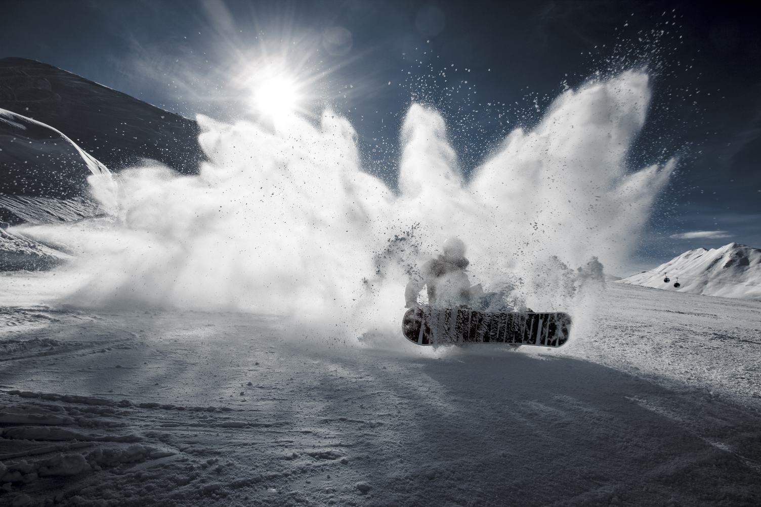 Snowboarder in Motion with Back Sun Light