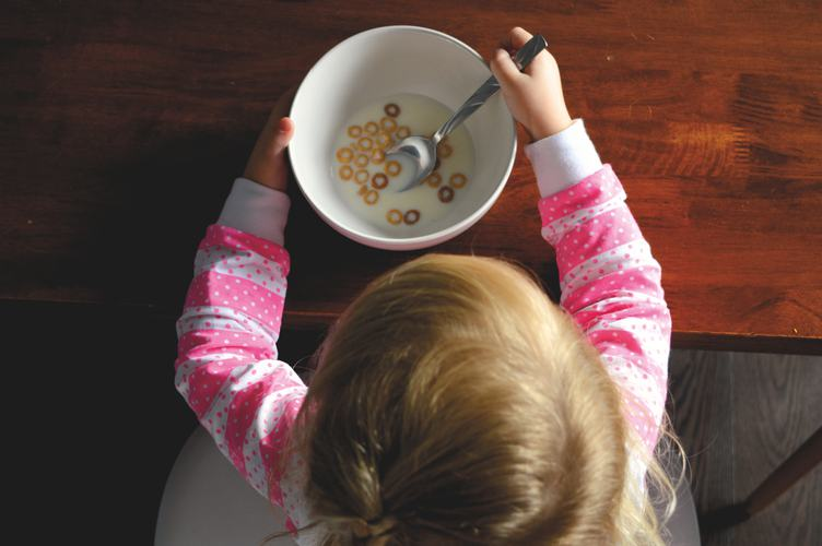 Little Girl Eating Cereals, Top View