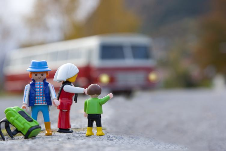 Miniature Family Traveling by Bus with Backpack, Macro Photography.