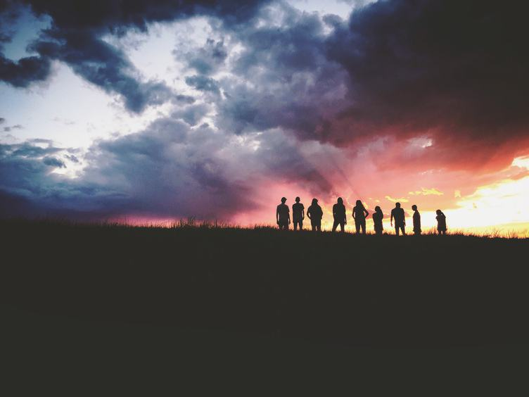Silhouette Group of People Looking at Beautiful Sunset Sky